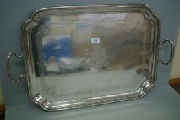 A heavy Victorian silver two handled tray of rectangular form with shaped corners, crested, London