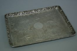 Good quality 19thC Chinese chased silver tray with decoration of bamboo edge, dragons in the