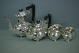 Four piece silver tea / coffee service of oval form with gadrooned border ebonised finials and