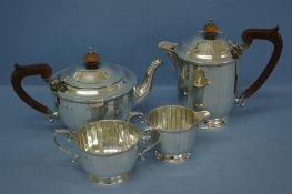 Art Deco four piece silver fluted tea service with gadrooned border and shell decoration. Birmingham