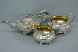 Good quality three piece chased silver tea service of circular form with decoration of flora and