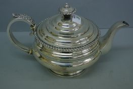 G IV silver circular tea pot with gadrooned border, acanthus decoration to handle. London 1825. 25.5