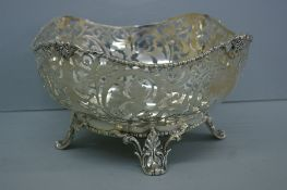 Victorian pierced silver fruit bowl with foliate decoration, cotton reel borders on splayed feet.