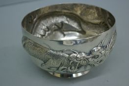 Late 19thC Chinese chased silver bowl with dragon decoration, diameter 4 inches