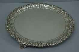 GIV silver waiter with acanthus and scroll decoration to border, on splayed feet. Sheffield 1824. 24