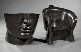 Pair of Art Moderne-Style Black Marble Face Chairs , barrel-form seats, h. 27 in., w. 25 in., d.