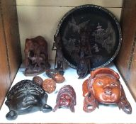SECTION 27. Four various carved and pierced coquilla nut pomanders, together with oriental carved