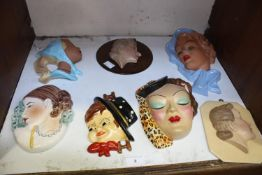 SECTION 8. Seven various art deco 'style' pottery wall masks including a West German Cortendorf