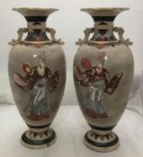 A pair of early 20th century large Japanese Satsuma vases, of baluster form, incised and painted