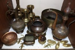SECTION 12. Various engraved brass and copperwares including Islamic style pots, ewers, vases,