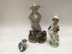 Three assorted Lladro ceramic figures comprising a Mexican ceramic street vendor, a girl holding a
