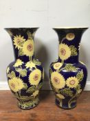 A pair of large Vietnamese floor vases, of baluster form, decorated with yellow and pink flowers