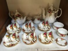 SECTIONS 1 & 2. A 49-piece Royal Albert 'Old Country Roses' pattern part tea and dinner service