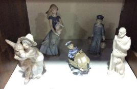 SECTION 18. Three Lladro figures including 'Little Skipper No. 5936', a boy hugging a donkey no.