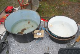 Two Cast iron cooking pots.
