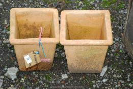 Two small terracotta square planters.