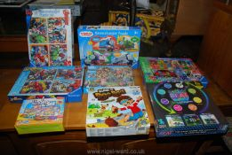 A quantity of children's games and Puzzles including Ravensburger Avengers, Thomas and Friends,