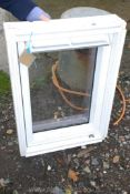 """A Velux window 31"""" x 22"""" (total size)."""