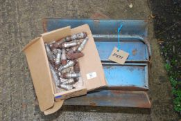 A Metal toolbox and spark plugs, possibly waterproof/ex-military vehicle.