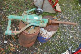 An Oil pump and two tins of oil.