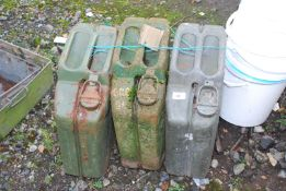 Three Jerry cans,