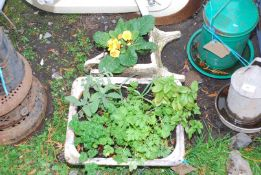 A small Wheelbarrow planted and herb container.