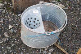 A galvanised Mop bucket.