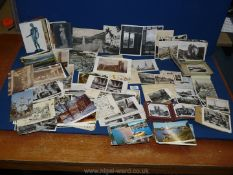 A box of mixed black and white postcards from Europe and London and coloured postcards from Milan,