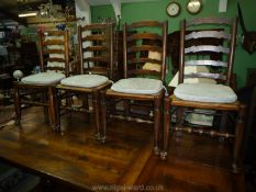 A set of four mixed woods, ladder-back Dining Chairs having woven sea-grass seats, turned legs,