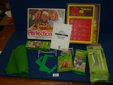 A boxed Deny's Fisher 'Perfection' game complete with contents and a Subbuteo table football game