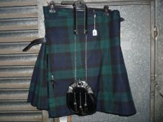 "A ""Kilt Society"" kilt in navy, blue and green tartan,"
