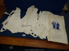 A box of 1920's evening wear including Harry Berman white evening waistcoats, spats, stiff collars,