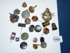 A quantity of military cap Badges and buttons, etc.