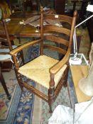 A good Oak ladder back open armed Elbow Chair having turned legs,