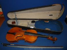"""A cased Violin and bow, body 14"""" long, total length 23"""" long,"""