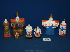 A box of miniature Japanese figures in china and wood,