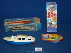 A Tri-ang mini models clockwork Cabin Cruiser,