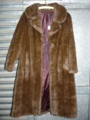 A brown faux fur full length coat by HF Couture London, possibly size S/M.