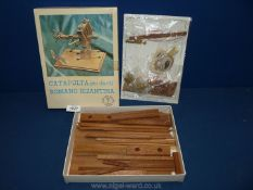 A good wooden and metal model kit of a Roman Byzantine catapult, with instructions.