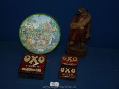 A Huntley & Palmer biscuit tin, three Oxo tins and a wooden figure of a man.