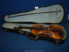 "A cased Violin, body 14"" long, total length 23"" long,"