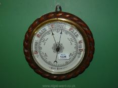 An aneroid Barometer with brass dial.