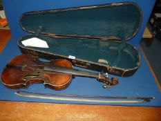 """An unmarked Violin, body 15 1/4"""" long, total length 26"""", in need of restoration, with bow and case,"""