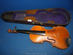 A Violin labelled J. Moores & Co.