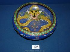 """A Chinese cloisonne shallow bowl, blue ground with bright dragons, 10"""" diameter."""