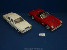 "Two vintage model cars including a ""Burago"" Rolls Royce Camargue and a ""Polistil"" red Ferrari."