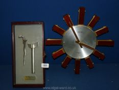 A glass fronted box bearing a reproduction of 'Antique Keris of Brunei Darussalam' (axe and dagger),