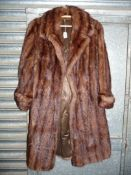 A brown 'mink style' three quarter length coat with three quarter length sleeves,