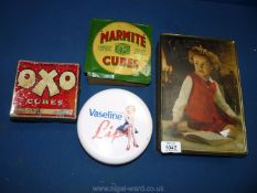 Three tins: Oxo, Marmite and Vaseline lips,