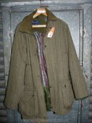 A Grass Roots Country Clothing green tweed coat with zipper and poppers, size M.